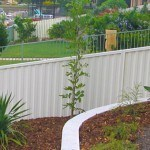 White colorbond fence RAKED