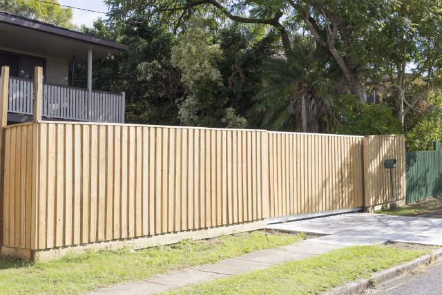 New lapp and cap front fence with sleeper under