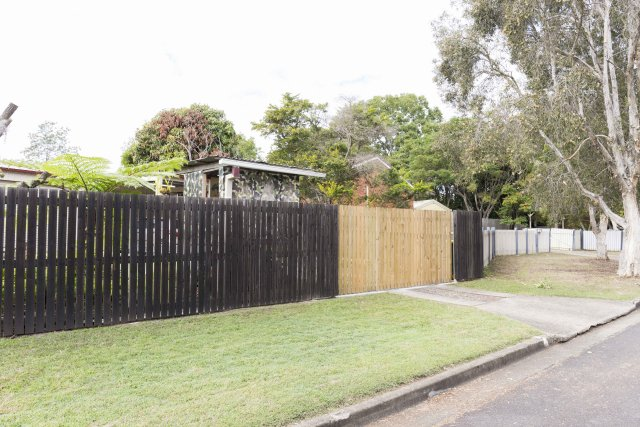 Old Fence new Sliding Auto Gate clad with Pine palings